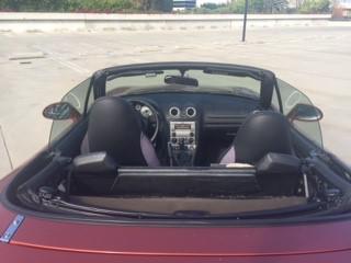https://www.autoshrine.com/registry/pictures/271802/2005_Mazda_MX_5_Lava_Orange_Sally_M_001.jpg